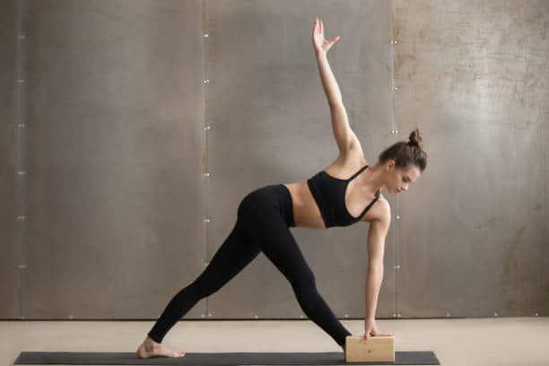 girl practice yoga with the help of yoga blocks