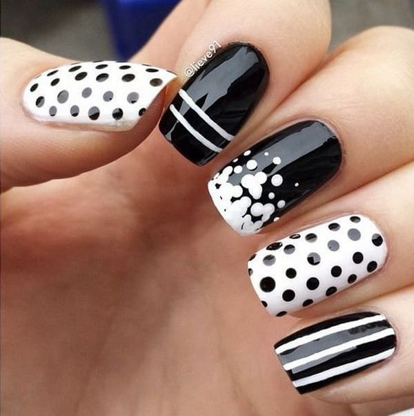 Black And White Nail Art With Polka Dots And Strips
