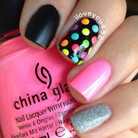 Quirky nail art with colorful polka dots.