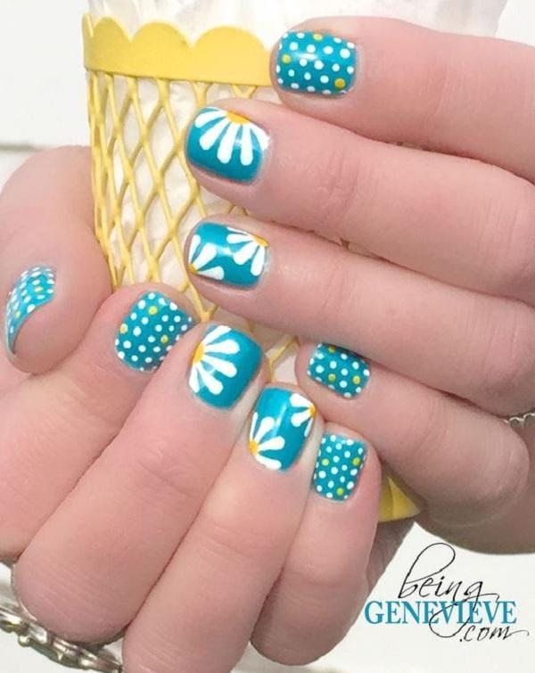 Sky blue Polka dots and daisy petals nail art