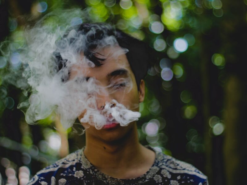 A boy is smoking and drug addicts